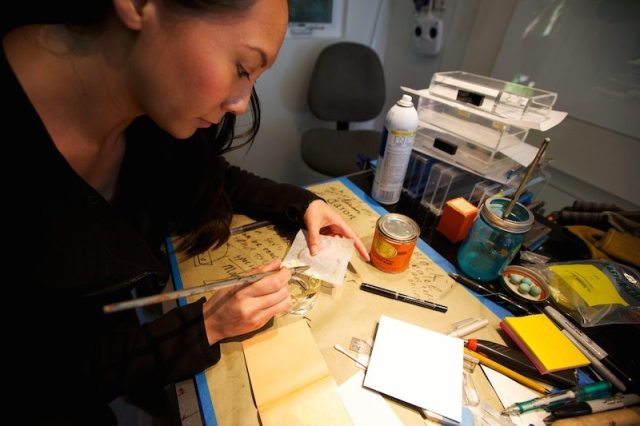 Stefanie Phan in the workshop creating the On The Money gold and acrylic cuff, $280 at stefaniephan.com