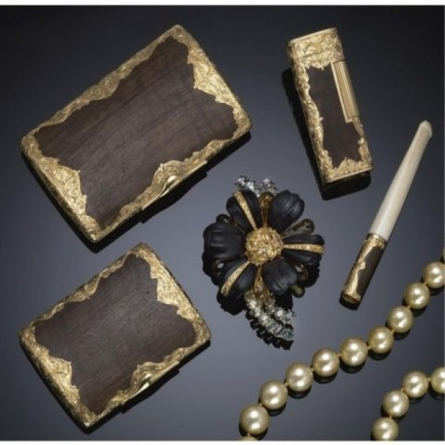 """Could you imagine having this stash of luxury in your purse?! Ballin'."" Craftsmanship embodied in this vintage 1960s collection of wood and gold compact, lighter, cigarette holder and ivory cigarette holder."