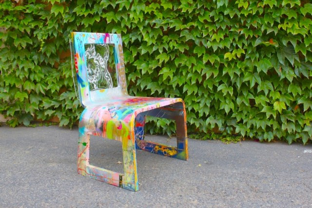 The Frenchie: Handmade acrylic chair featuring hand carved French colonial seat back and hand painted by Aaron R. Thomas. SHOP THIS LOOK