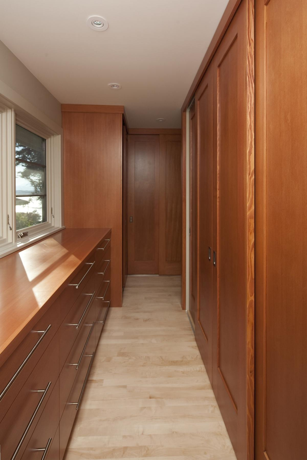 Hallway through light brown drawers & sliding doors