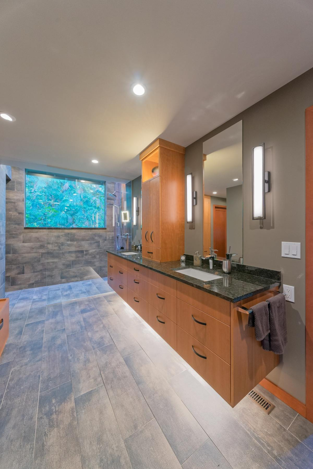 long horizontal tan vanity cabinets with under lighting