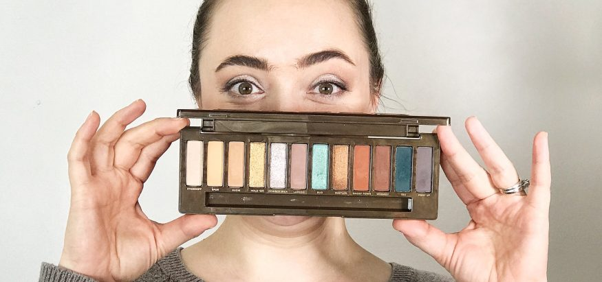 Beauty Blogger Stef holds up her new palette from Urban Decay: the new Naked Wild West Eyeshadow palette