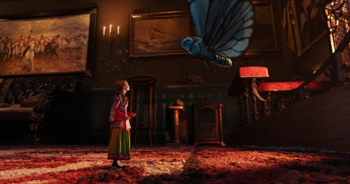Alice (Mia Wasikowska) and Absolem (the voice of Alan Rickman) converse in Disney's ALICE THROUGH THE LOOKING GLASS, an all new adventure featuring the unforgettable characters from Lewis Carroll's beloved stories.
