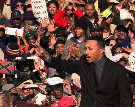 **ADVANCE FOR THURSDAY, FEB. 12** In this Jan. 17, 2000 file photo Kweisi Mfume, president and CEO of the NAACP, waves to the crowd during a rally in Columbia, S.C. An estimated 46,000 people gathered to demand the removal of the Confederate flag from the dome of the Statehouse. (AP Photo/Lou Krasky, file)