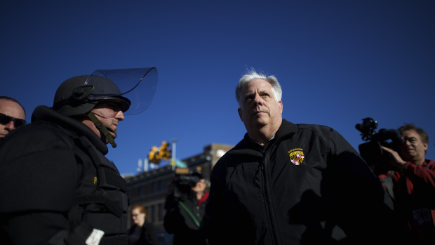 BALTIMORE, MD - APRIL 28: Maryland Governor Larry Hogan greets Baltimore police dressed in riot gear the morning after citywide riots following the funeral of Freddie Gray, on April 28, 2015 in Baltimore, Maryland. Gray, 25, was arrested for possessing a switch blade knife April 12 outside the Gilmor Houses housing project on Baltimore's west side. According to his attorney, Gray died a week later in the hospital from a severe spinal cord injury he received while in police custody. (Photo by Mark Makela/Getty Images)