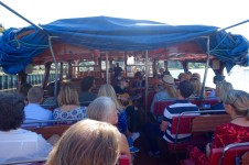 Local artist Stina Stjern performing on a boat trip to the festival area.