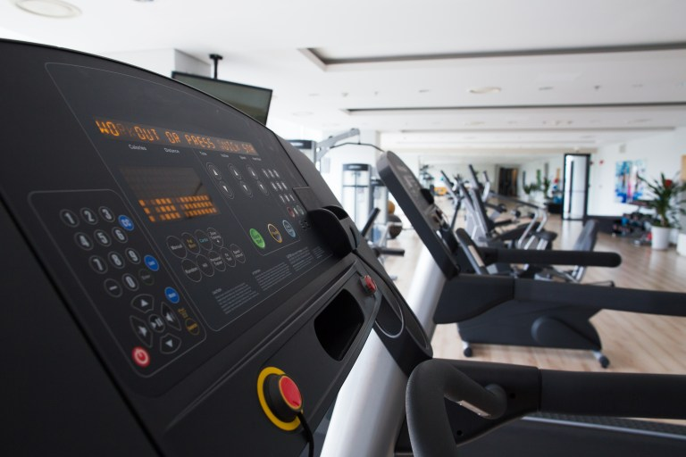 Close-up of treadmill console with settings in fitness gym