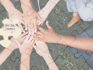 composite image of jigsaw pieces with hands-on a circle for Starting an Erotic Writing Group blog post