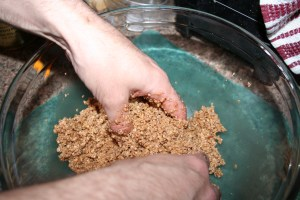 hand mixing crunchy stuff