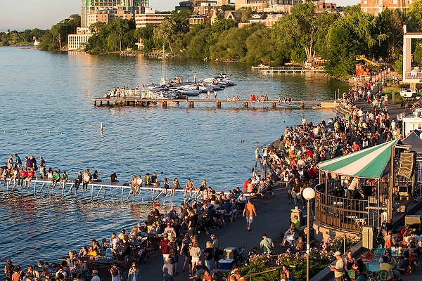 Image: People relax along swimming pier at Memorial Union Terrace