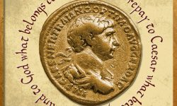 Gold Roman aureus coin of Roman emperor Trajan AD 98-117 isolated on a white background as a black and white image