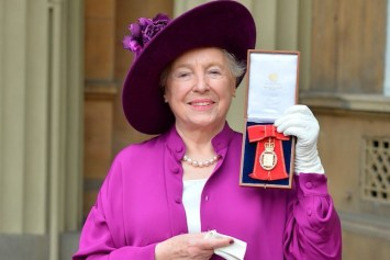 Image of Stephanie Shirley holding an award.