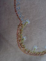 J's cushion detail- dandelions, soil, grass and sky (embroidery) 2014