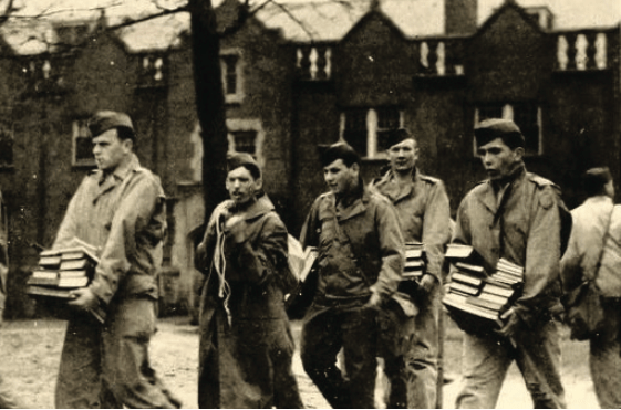 Students from the army training program carry books in front of Carnegie Hall.