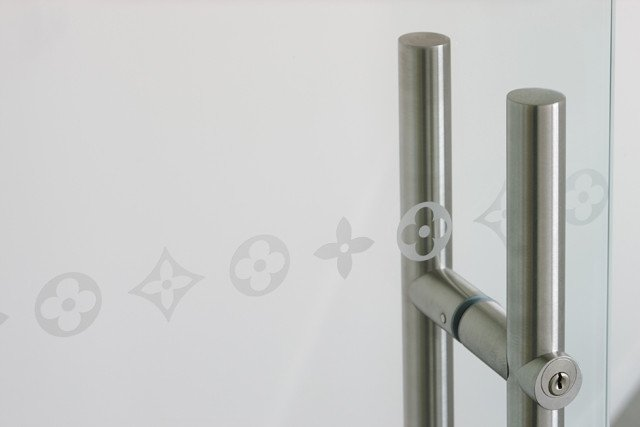 glass door with LV logo