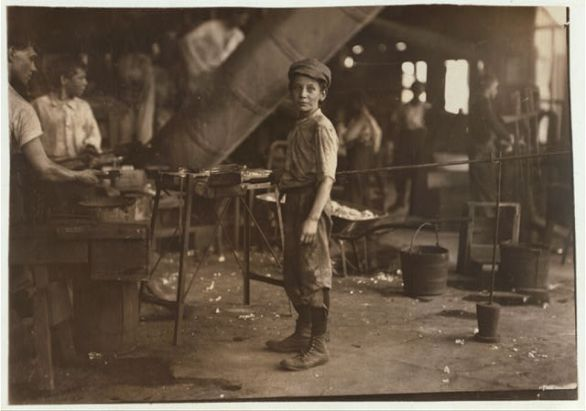 """""""Carrying-in"""" boy in Alexandria Glass Factory, Alexandria, Va. Works on day shift one week and night shift next week. Lewis Hine (1911). Courtesy the Library of Congress, Washington, D.C."""
