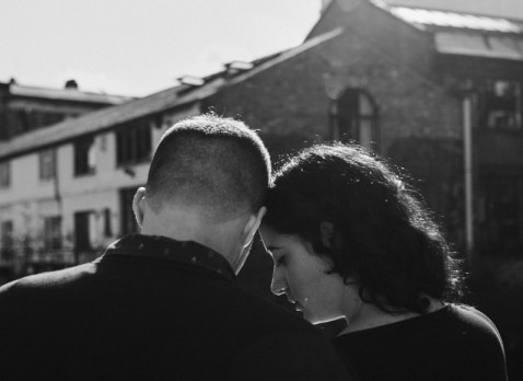 Black and white image of a couple with foreheads together