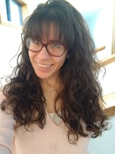 Stephanie Cristi tells of her process restyling her look to include long curly hair with straight bangs.