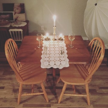 date night dinner table setup lace doily wine candles fancy
