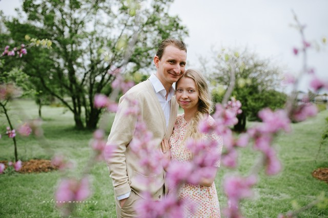 stephanie de montigny cherry blossoms arboretum photos ottawa melissa morrissey photography man vintage cardigan with woman with blue eyes, curly blonde hair, and stunning pink polka dot dress