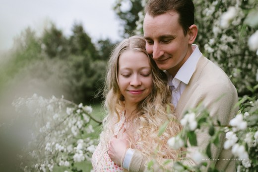stephanie de montigny white cherry blossoms photos ottawa melissa morrissey photography fiance hugging bride, curly blonde hair, stunning pink vintage dress, natural cardigan with elbow patches love