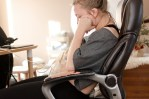 exclusively breastfeeding working mom mama sitting in desk chair pumping