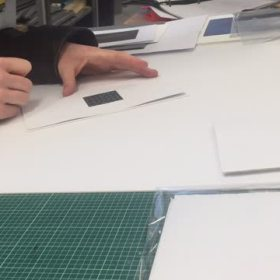 Hands signing etchings