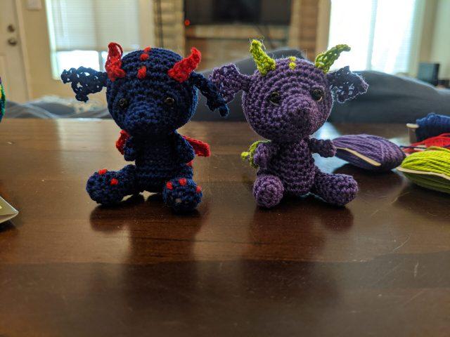 Two micro-crochet dragons
