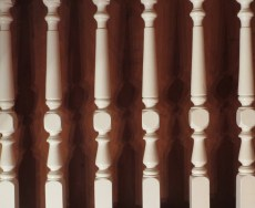 Lamp light creates a row of ghost spindles