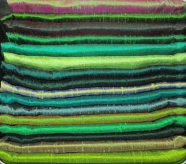 From cotton to silk/A pinking zig-zag edging/Will keep fray away
