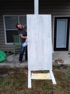 DIY: A hundred year old barn door becomes a headboard