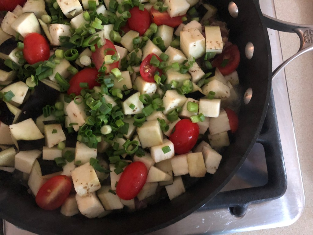 Skillet with vegetables being cooked