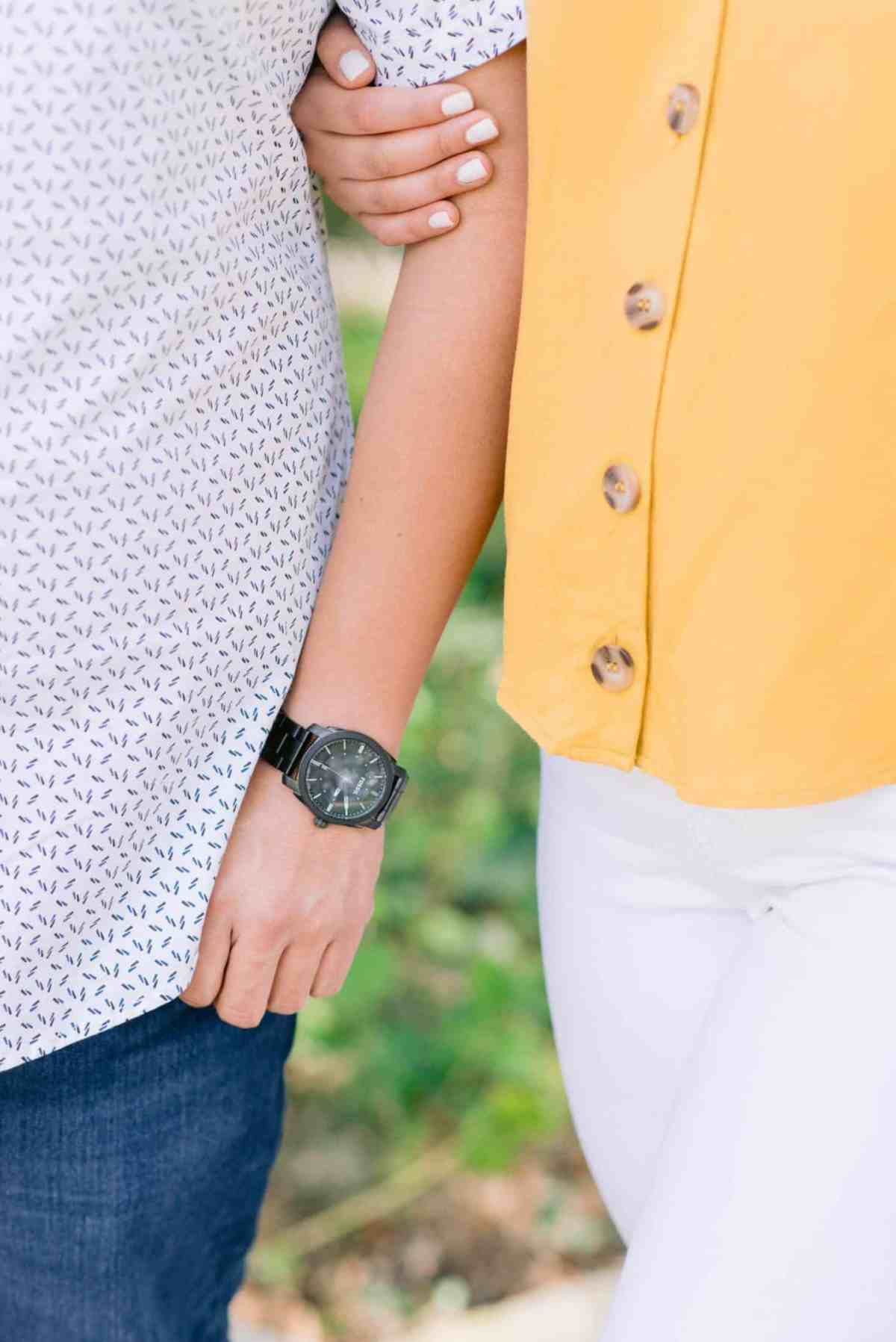 detail shot of couples outfits at their engagement session at laguna gloria in austin texas