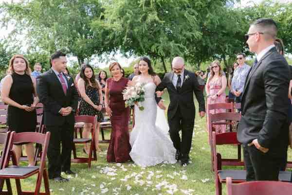 Bride walking down aisle at Thistlewood manor & gardens wedding