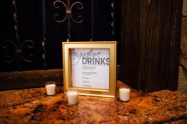 Design for wedding, Signature Drinks sign in gold frame surrounded by three tea candles