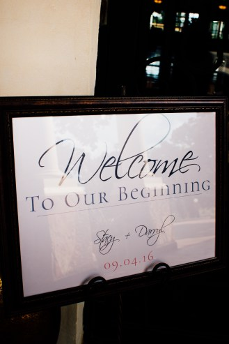 """Large """"Welcome to our beginning"""" welcome sign in frame."""