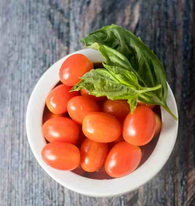 Tomatoes and Fresh Basil in a white bowl.