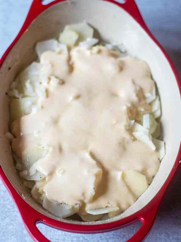 cheesy scalloped potatoes in pan prior to baking.