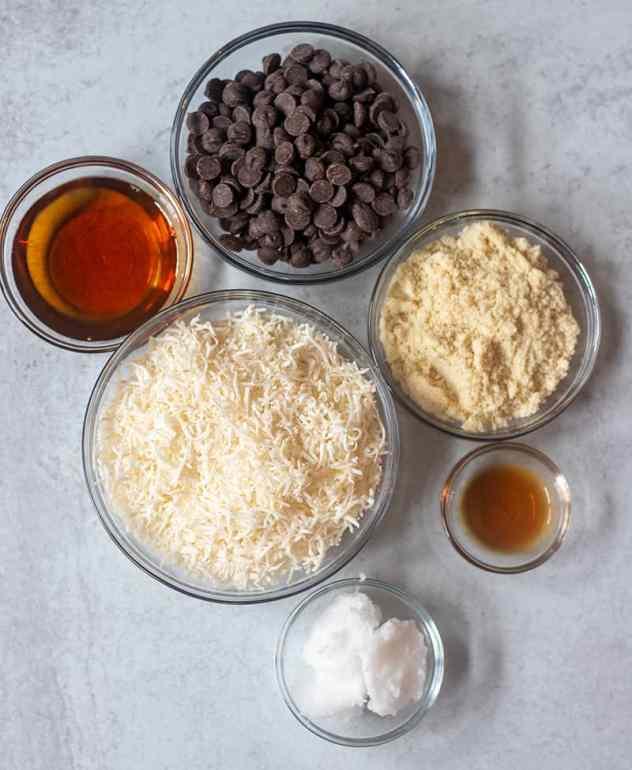 maple syrup, shredded coconut, dark chocolate chips, almond flour, vanilla extract, coconut oil