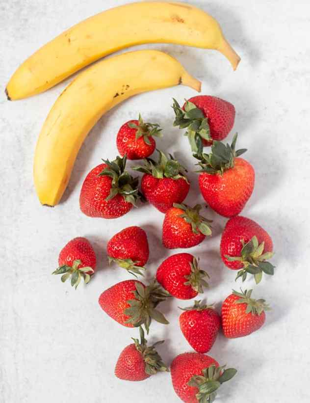 Strawberry Milkshake ingredients which includes bananas and strawberries