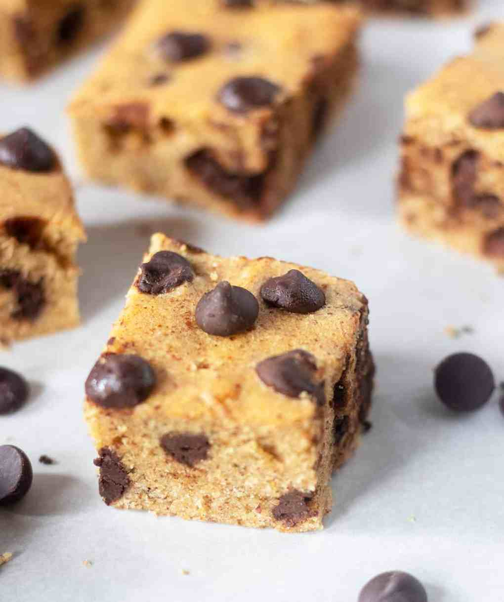 Chocolate Chip Cookie Bars baked and cut on parchment paper