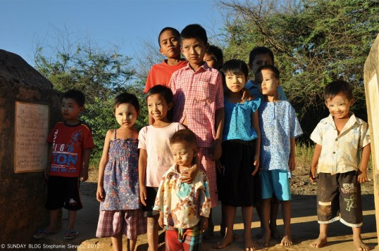 Kids with different thanaka patterns, Myanmar