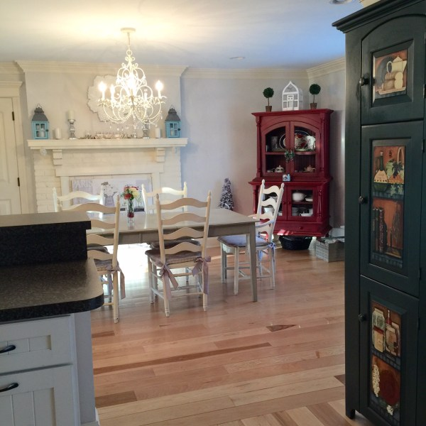 OUR SPACE—While the red hutch is very pretty, I think turning into a pretty turquoise is going to look great in the room. With colors such as grey, white, and black to anchor the room, a pop of turquoise may be just what the Kitchen Renovation Doctor ordered.