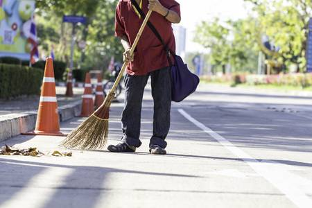 116140480-man-cleaning-staff-sweeping-garbage-on-the-road-on-sunny-days-