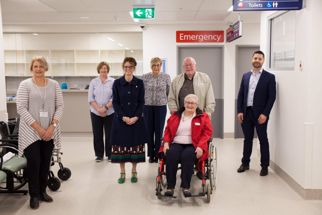 Steph Cooke, MLHD staff and hospital auxiliary members stand in the new facility.