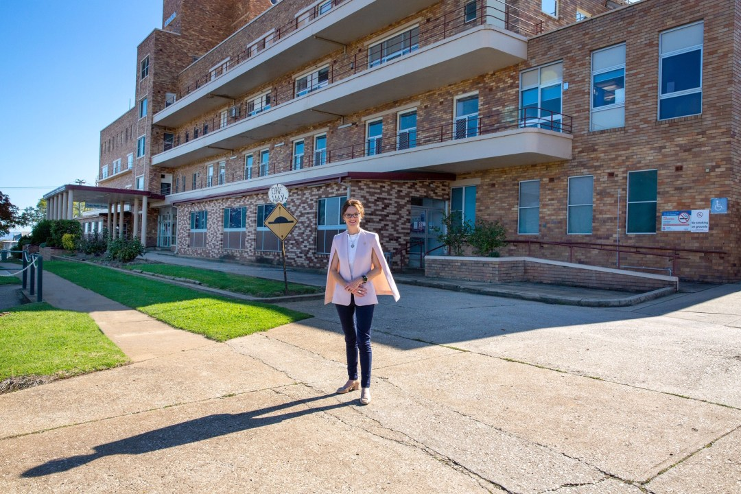 Steph Cooke stands in the sunshine out out the front of the Cowra Hospital.