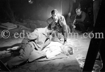 """Brigitte Bardot and Stephen Boyd during the filming of """"Les Bijoutiers du clair de lune"""" (""""The Night Heaven Fell""""), on the grounds of the Victorine Film Studios in Nice. Directing the film is Brigitte's ex-husband Vadim (in the middle). Nice 1958."""