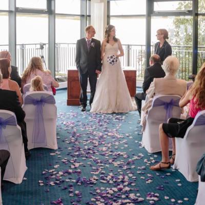 Norfolk wedding photographer – bride and groom confetti walk