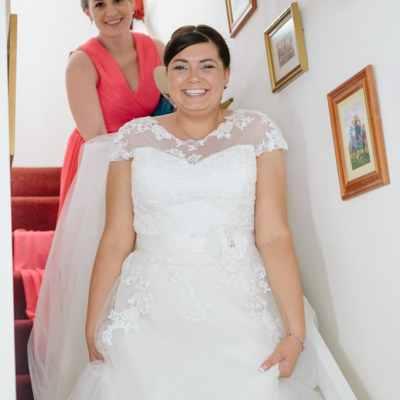 Norfolk wedding photographer – bride walking downstairs