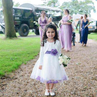 Norfolk wedding photographer – flower girl smiling